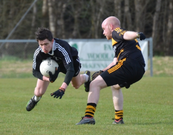 Mickey Gallagher helps St. Enda's Reserves get the defence of their Division One league title off to a flyer at Augher.