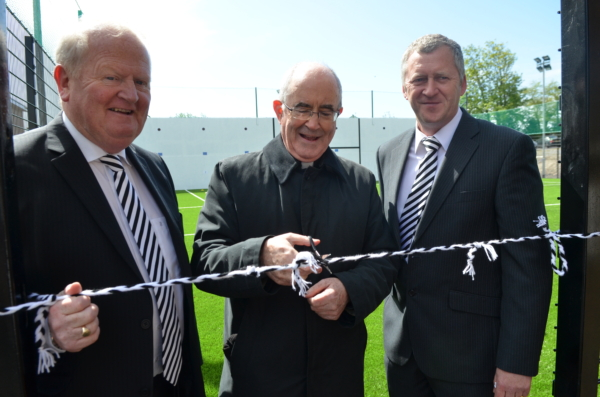Open for business...Monsignor Donnelly, watched by Club Omagh Chairman Seamus Hannigan and St. Enda's Executive Committee Chairman John McElholm, cuts the ribbon to officially open the new Ball Wall and 4G training area at Healy Park. The new facility which has taken just six months to complete, is the third new development project at St. Enda's with our Club Omagh fund-raising committee instrumental in raising necessary funds for work at the club. Earlier projects included the re-opening of St. Patrick's Park and the Club Gym at Healy Park. Many thanks to all the Club Omagh members whose financial contribution has been key to the work at the club.